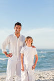 Father and son at the beach. Young father and son at the beach royalty free stock photo