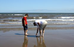 Father and son on beach Stock Photos