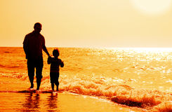 Father and son on the beach. Happy father and son on the beach stock images