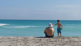 Father and son on the beach. Talking to each other Royalty Free Stock Photos