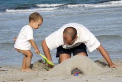 Father and son on the beach royalty free stock photography