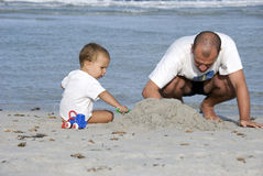 Father and son on the beach Stock Images
