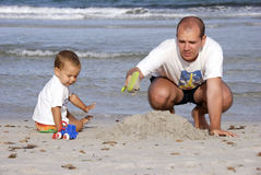 Father and son on the beach Stock Photography