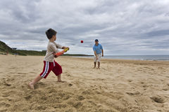 Father and son on beach Stock Image