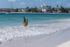 Father and son on beach Barbados Royalty Free Stock Photo