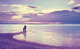 Father and son on the beach. At beautiful evening Stock Photo