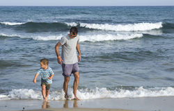 Father and son at beach Royalty Free Stock Image