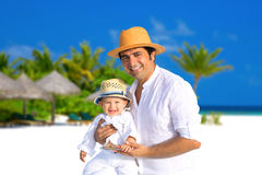 Father and son on the beach Royalty Free Stock Photo