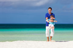 Father and son at beach Stock Photography