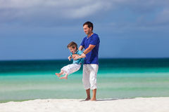 Father and son at beach Stock Images