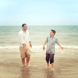 Father and son on beach having a conversation Royalty Free Stock Photography