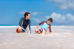 Father with son at beach Stock Image