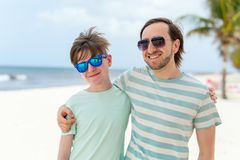 Father and son at beach. Father and his teenage sun at beach royalty free stock images