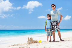 Father and son at beach Stock Photos