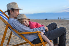 Father and son at the beach. Father holding his little son at the beach Royalty Free Stock Photography