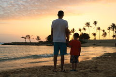 Father and son on a beach. Stock Images