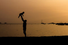 Father and Son Beach Silhouette Stock Images