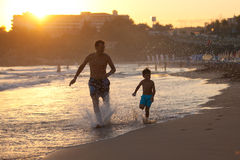 Father and son on the beach at sunset Royalty Free Stock Photography