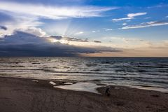 Father and son on the beach, sunset over polish sea baltic.  royalty free stock photo