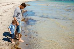 Father and Son on a Beach Vacation Stock Images