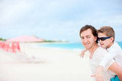 Father and son on a beach vacation Royalty Free Stock Image