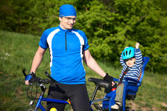 Father with son on bicycle Royalty Free Stock Image