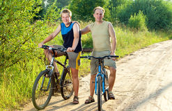 The father with the son on bicycles Royalty Free Stock Photos