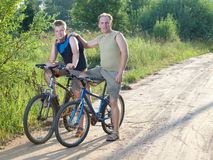 The father with the son on bicycles Stock Images