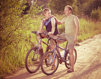 The father with the son on bicycles,with retro effect Stock Photos
