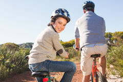 Father and son on a bike ride. On a sunny day Royalty Free Stock Photo