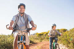 Father and son on a bike ride Stock Images