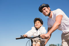 Father and son on a bike ride Royalty Free Stock Photo