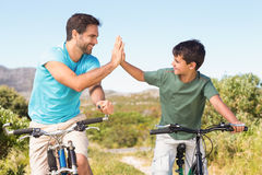Father and son on a bike ride Stock Photography