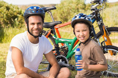 Father and son on a bike ride Royalty Free Stock Photos