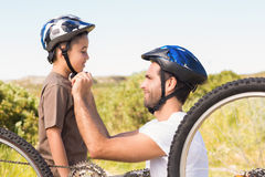 Father and son on a bike ride Royalty Free Stock Image
