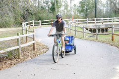 Father and son on bike trail. Caucasian father and son enjoying a bike ride on a country bike trail Royalty Free Stock Photos