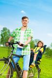 Father with son on a bike Royalty Free Stock Photos