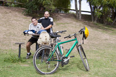 Father and son with bikes. Father and son with their mountain bikes Royalty Free Stock Photos