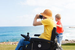 Father and son with binocular Royalty Free Stock Images