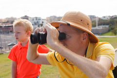 Father and son with binocular Stock Image