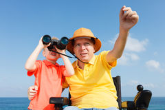 Father and son with binocular Stock Photo