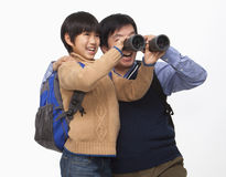 Father and son with binoculars Royalty Free Stock Photography