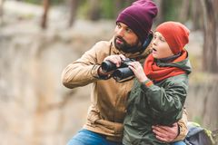 Father and son with binoculars stock image