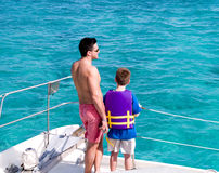 Father and Son Boating. Father and son watching the Caribbean sea from the stern of a pleasure boat Stock Photo