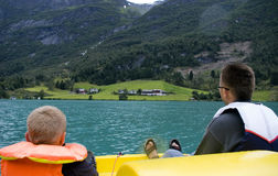 Father and son boating on lake Stock Image