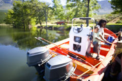 Father and son boating on lake Stock Photo
