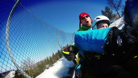Father and son on the Bobsleigh attraction during winter holiday. stock video footage
