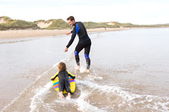 Father and son with Bodyboard Royalty Free Stock Photo