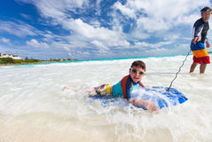 Father and son boogie boarding Royalty Free Stock Images