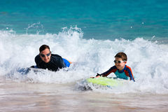 Father and son boogie boarding Stock Image